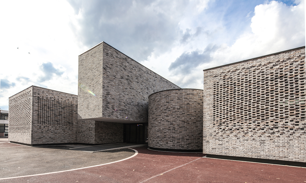 Hand-crafted bricks add visual depth to this French music school