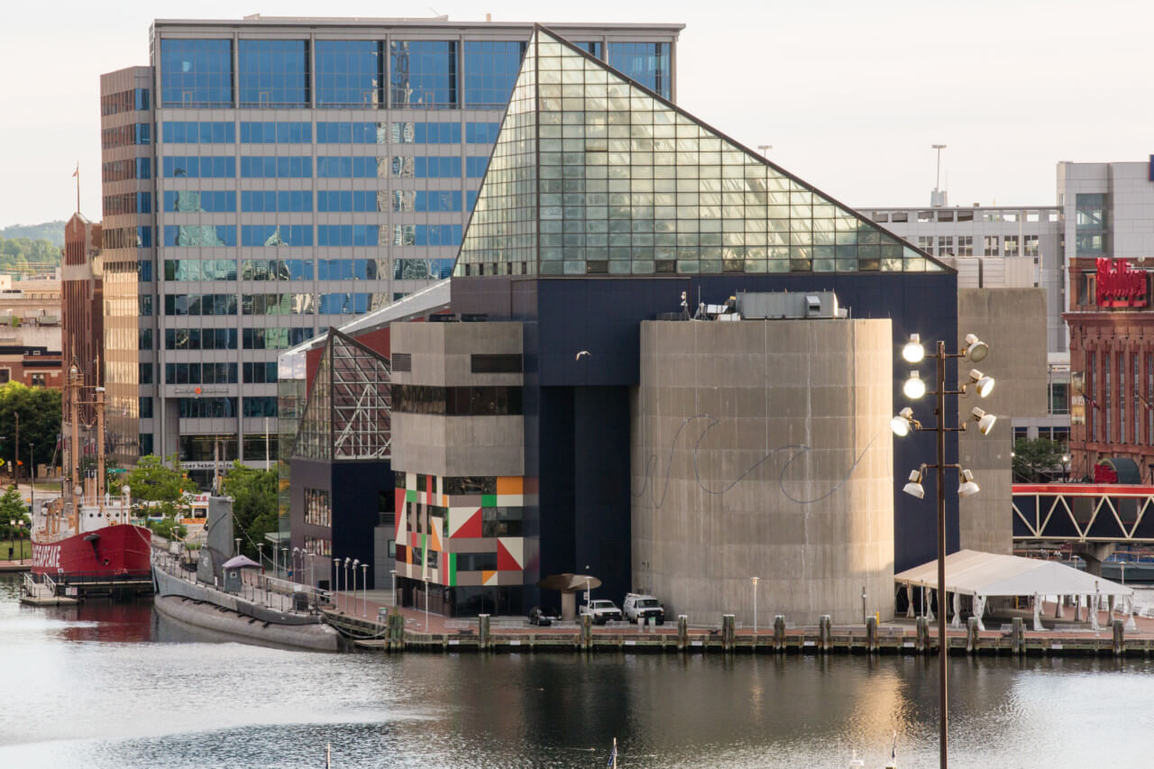The national aquarium in baltimore, with a jutting triangular glass topper