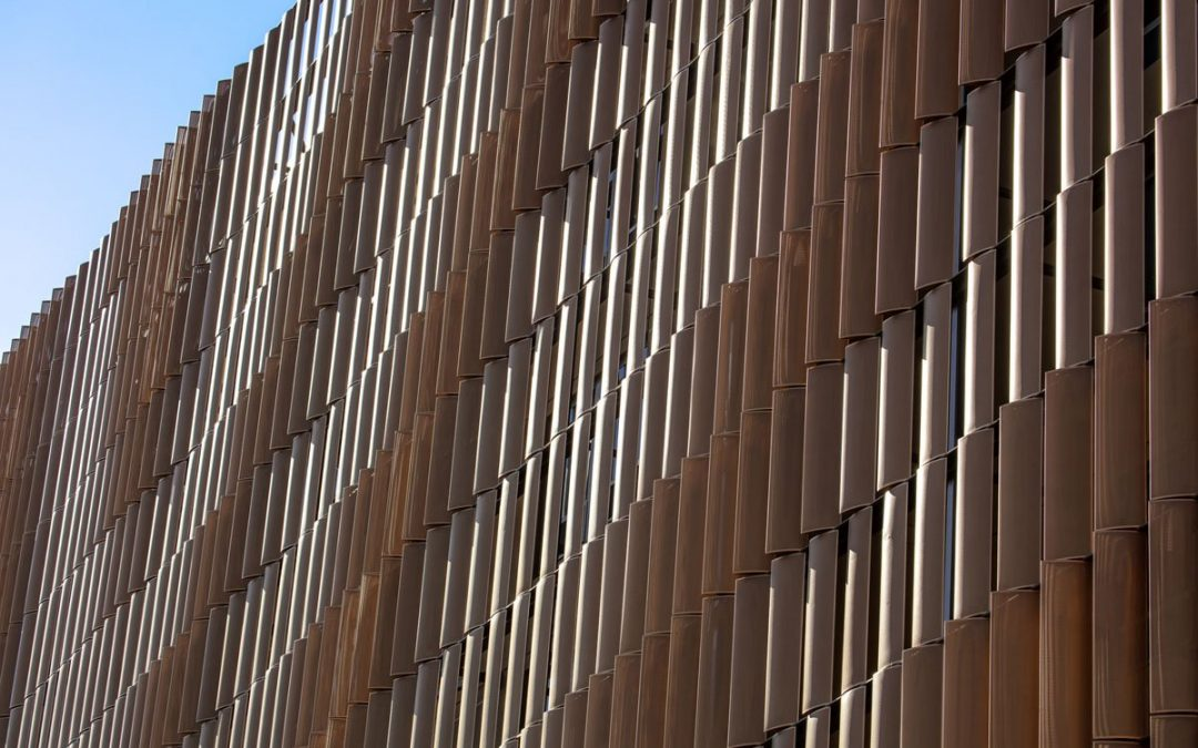 At Arizona State University, pixelated aluminum louvers shade residence hall