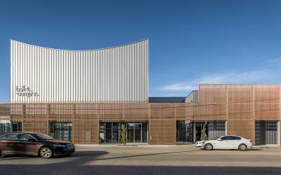 The Ballet Memphis building shines behind a corrugated copper curtain