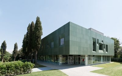 This mental health facility creates calm with a perforated green facade