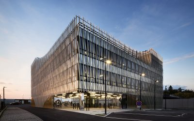 Aluminum complements wood in this office building's woven skin