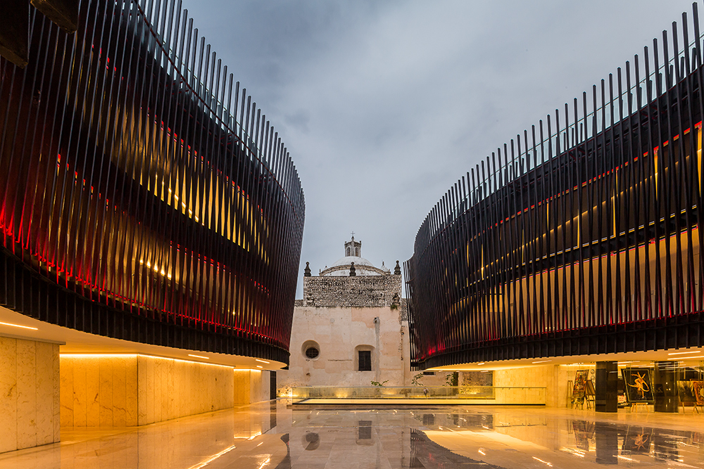 The Palace for Mexican Music sings with local stone and dramatic steel ribs
