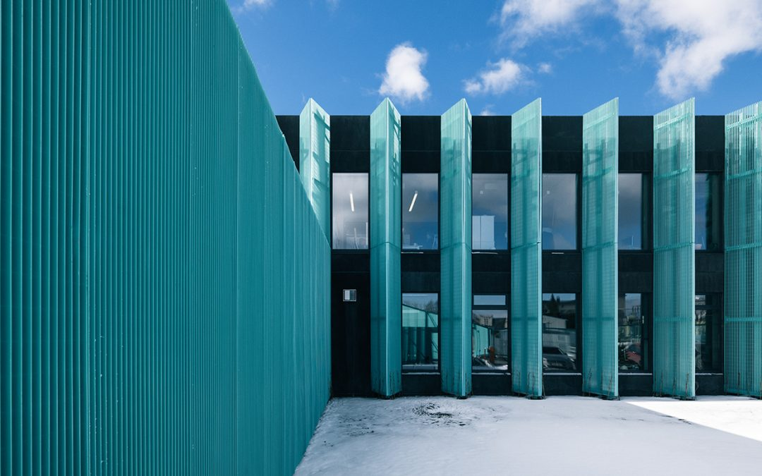 An Estonian office block receives a splash of color with an aluminum mesh facade