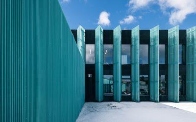 An Estonian office block receives a splash of color with an aluminum mesh facade