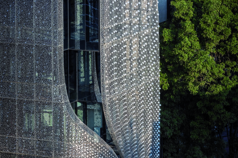 This office building in Mexico City filters sunlight through a flowing steel veil