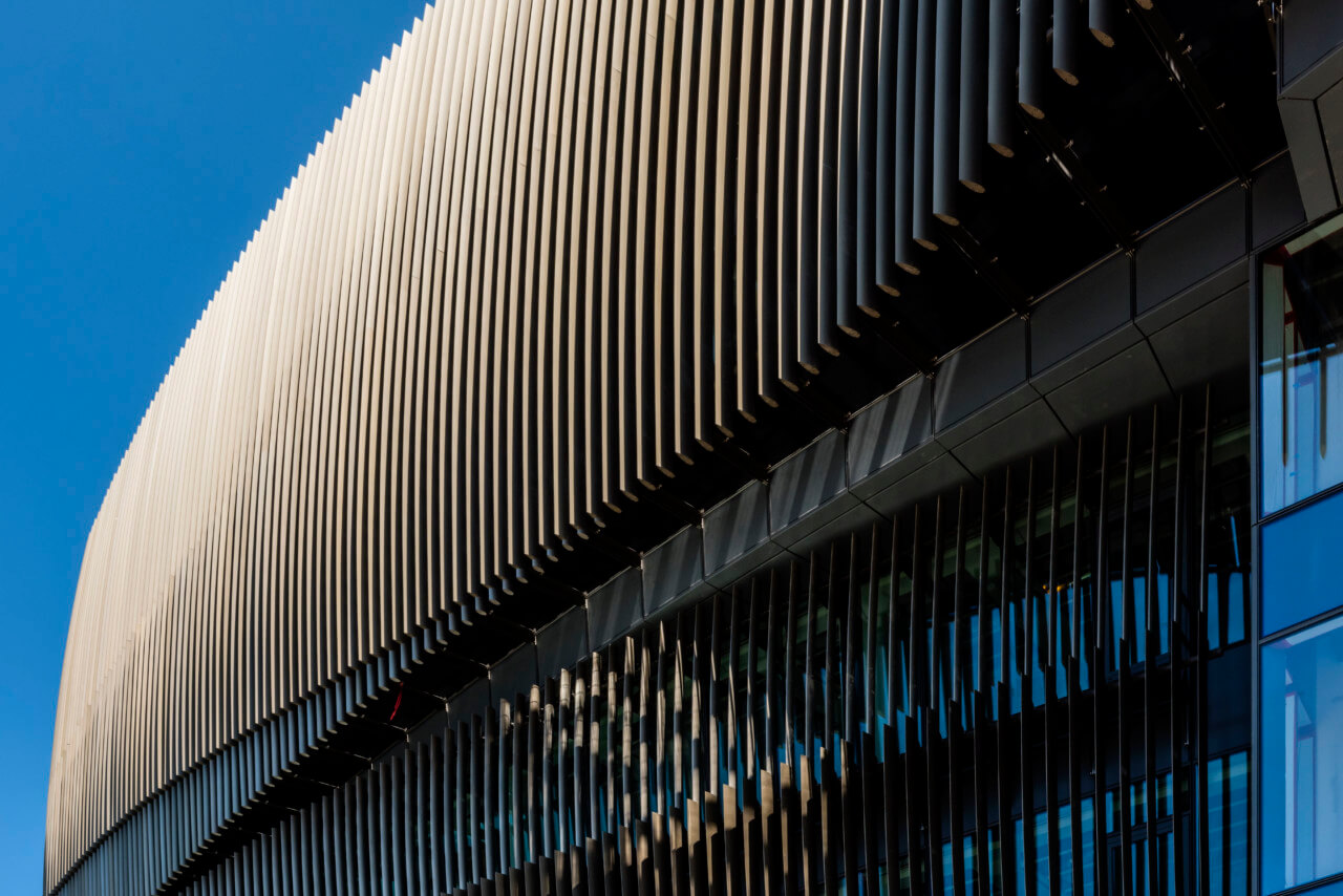 close up of the ribbed bronze fins of facade on the northeastern campus