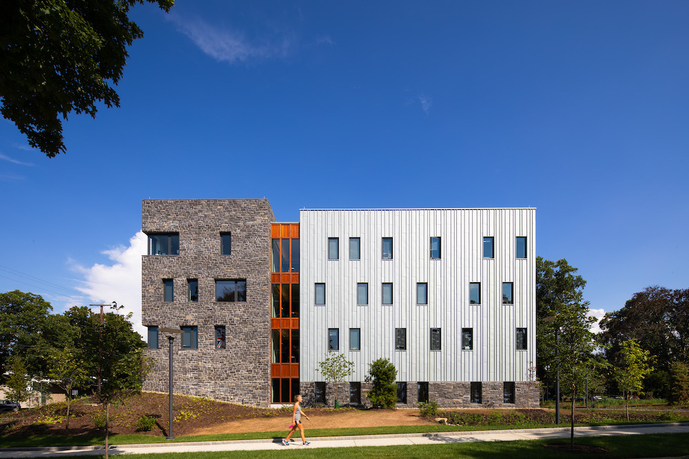 Deborah Berke Partners splits this dormitory with a zinc-and-stone facade
