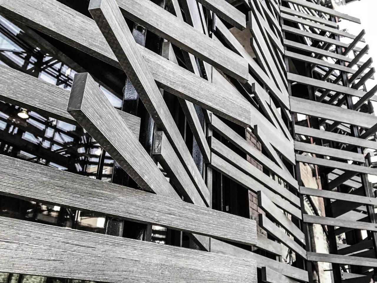 light gray trespa panels of folding slatted facade