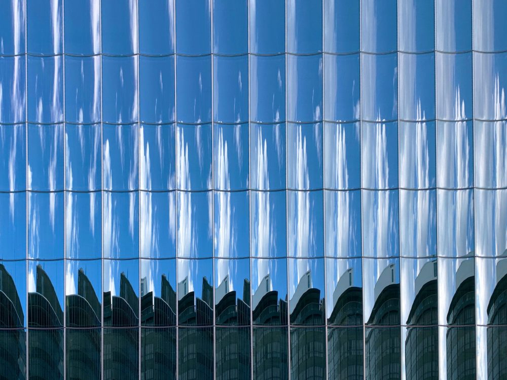 Glass panels with the sky reflected