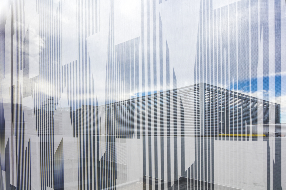 French 2D enlivens a Cambridge parking garage with a graphic-printed mesh facade