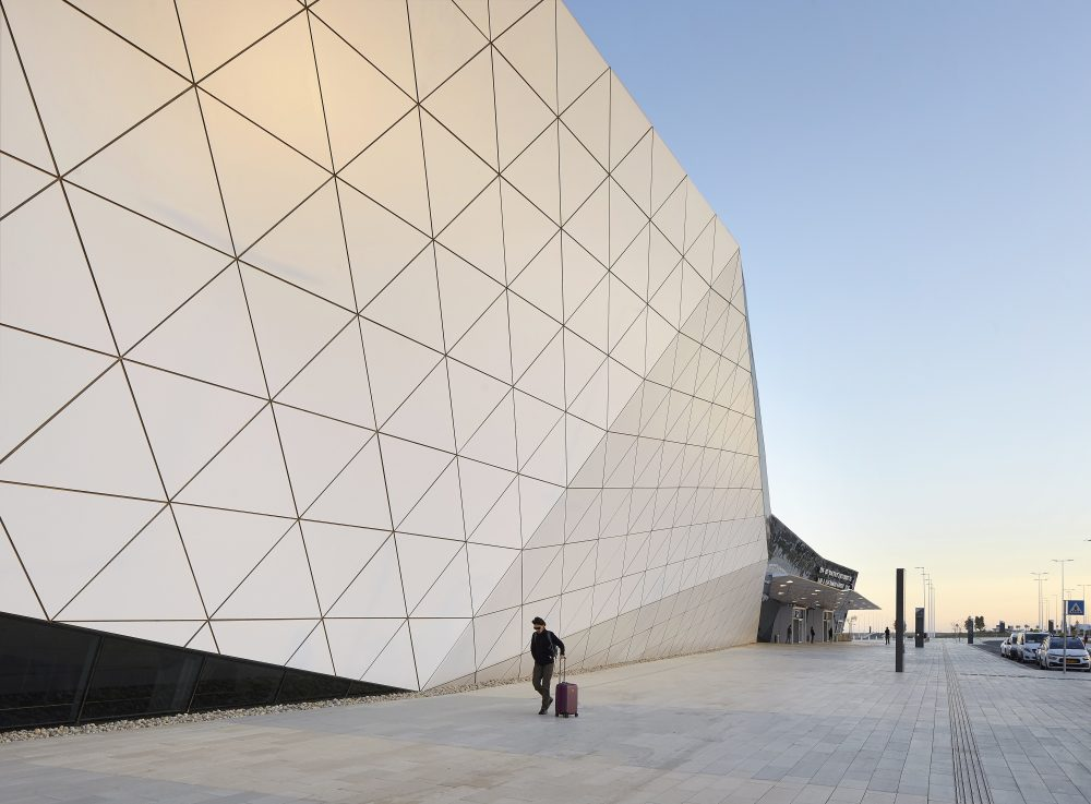 An Israeli airport rises from the desert with a contorted aluminum facade
