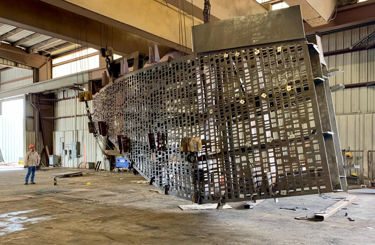 image of a piece of the building being welded together