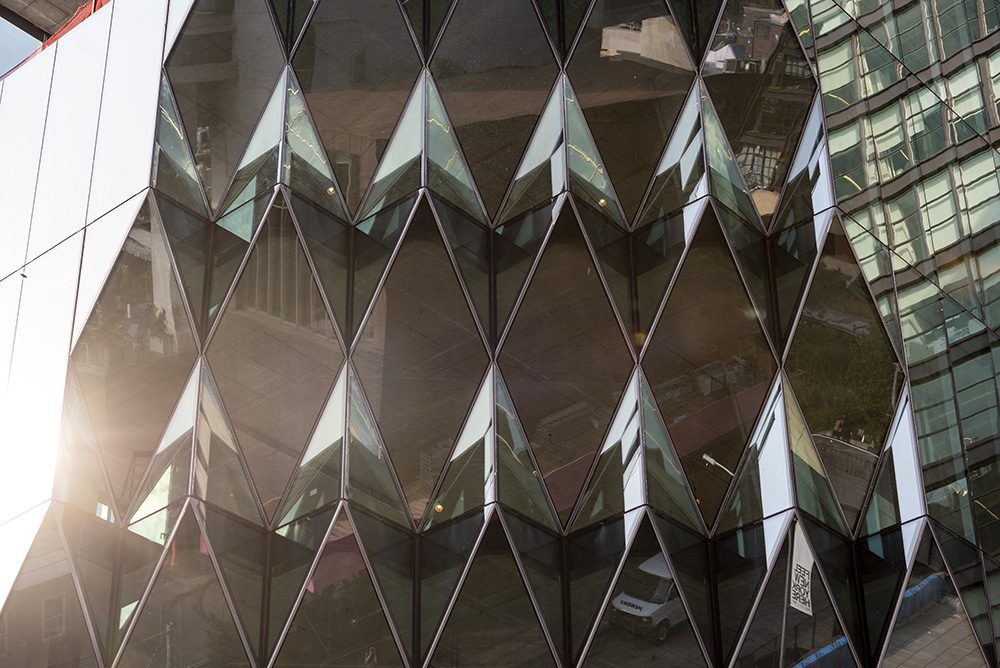 A pleated glass facade of the tower formerly known as Solar Carve