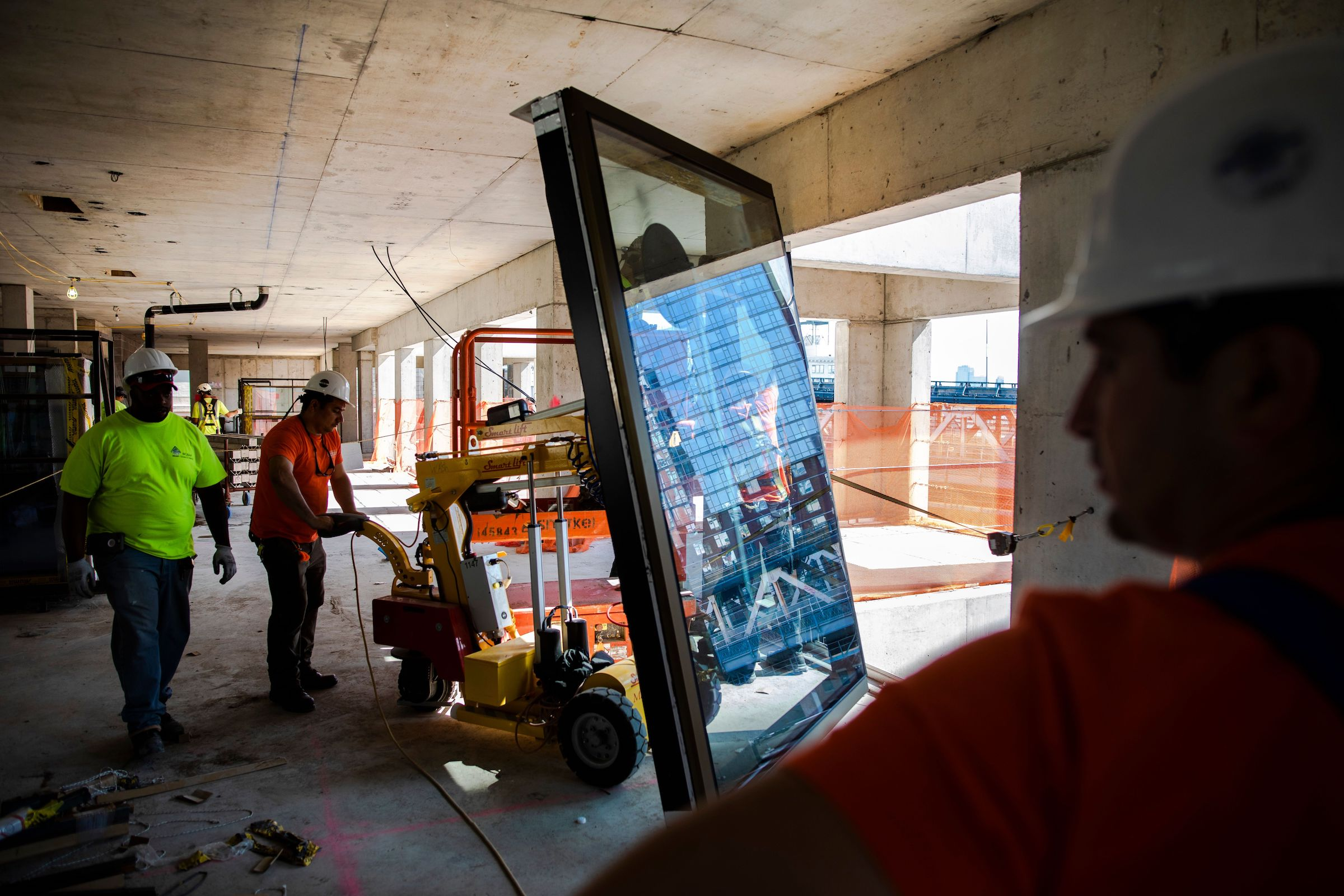 Window panels for ODA's 98 Front Street being installed (Photo Credit Dan Balilty)