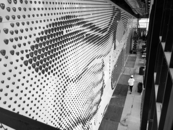 Photo during the construction phase of the guitar pick feature wall