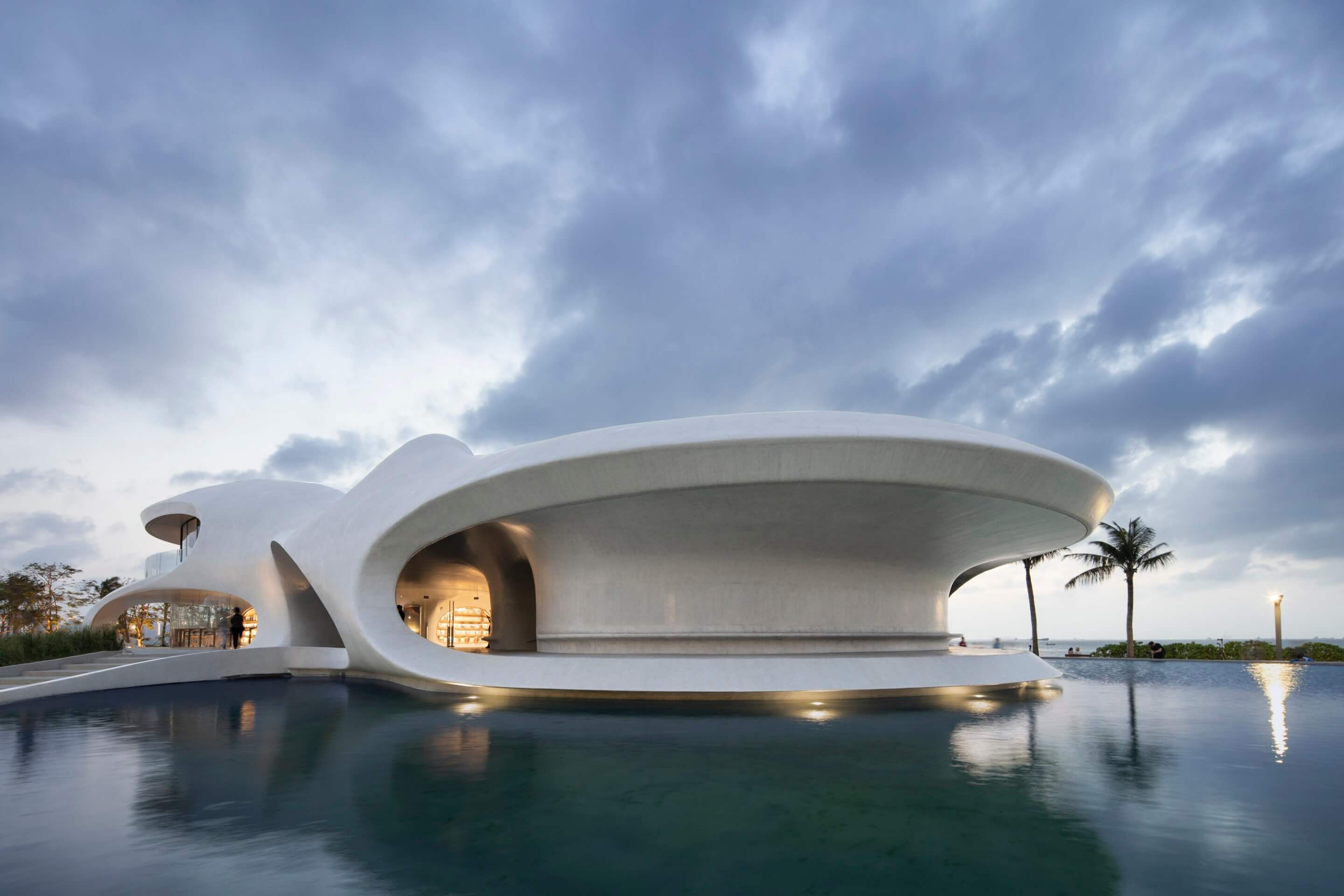 sinuous concrete form of the open terrace facing the water
