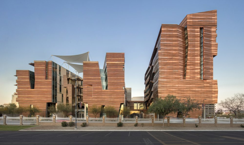 This Arizona medical school blends into the desert with a folded copper facade