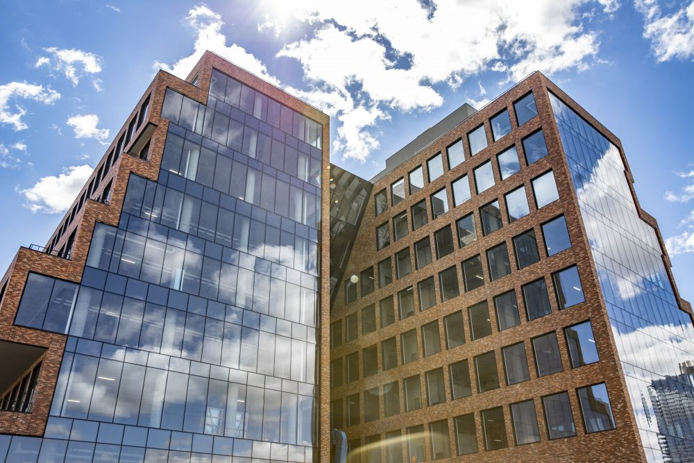 Brooklyn waterfront office building features brick and glass curtain facades