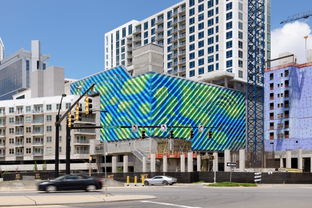 MARC FORNES / THEVERYMANY splashes this parking garage with swirling colors